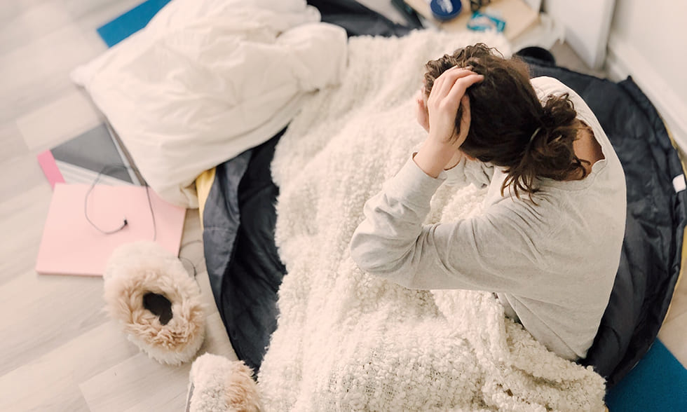 Title image: Woman wondering in bed: Why can't I sleep?